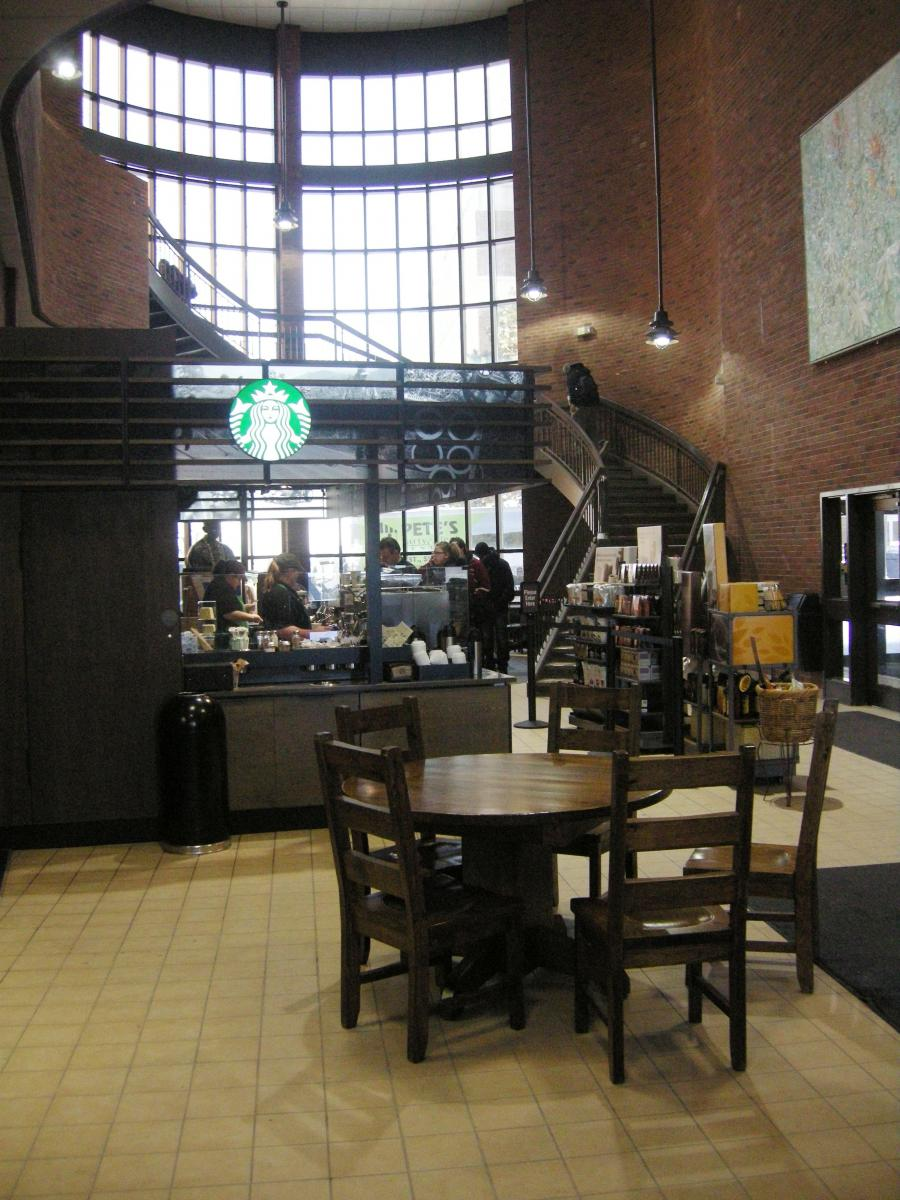 photo of the main stairwell leading up to the Library with the Starbucks café